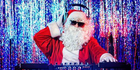 bigstock-DJ-Santa-Claus-mixing-up-some-39865849
